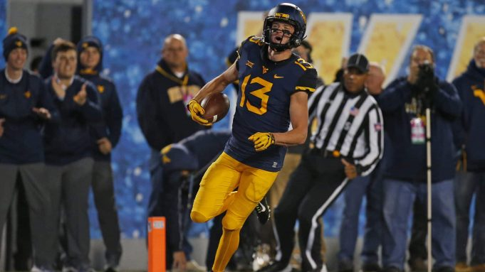 MORGANTOWN, WV - OCTOBER 25: David Sills V #13 of the West Virginia Mountaineers celebrates after catching a 65 yard touchdown pass in the first half against the Baylor Bears at Mountaineer Field on October 25, 2018 in Morgantown, West Virginia.