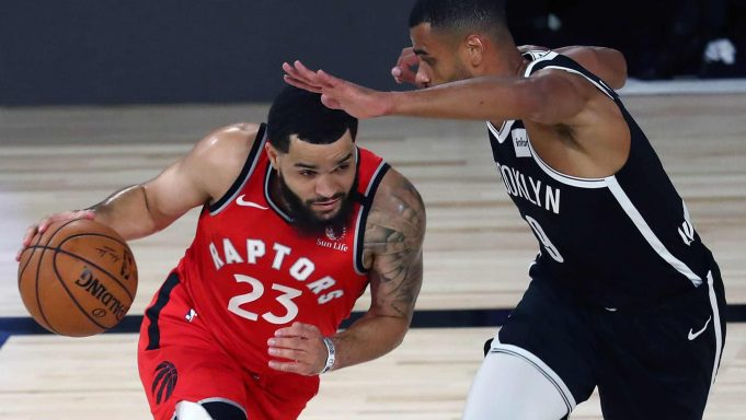 LAKE BUENA VISTA, FLORIDA - AUGUST 23: Fred VanVleet #23 of the Toronto Raptors moves the ball against Timothe Luwawu-Cabarrot #9 of the Brooklyn Nets during the first half in game four of the first round of the NBA playoffs at The Field House at ESPN Wide World Of Sports Complex on August 23, 2020 in Lake Buena Vista, Florida. NOTE TO USER: User expressly acknowledges and agrees that, by downloading and or using this photograph, User is consenting to the terms and conditions of the Getty Images License Agreement.