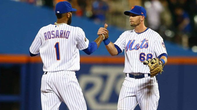 NEW YORK, NY - AUGUST 04: Amed Rosario #1 and Jeff McNeil #68 of the New York Mets celebrate after defeating the Atlanta Braves 3-0 at Citi Field on August 4, 2018 in the Flushing neighborhood of the Queens borough of New York City.
