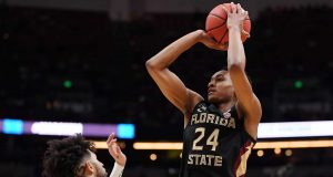 ANAHEIM, CALIFORNIA - MARCH 28: Devin Vassell #24 of the Florida State Seminoles shoots the ball against Josh Perkins #13 of the Gonzaga Bulldogs during the 2019 NCAA Men's Basketball Tournament West Regional at Honda Center on March 28, 2019 in Anaheim, California.