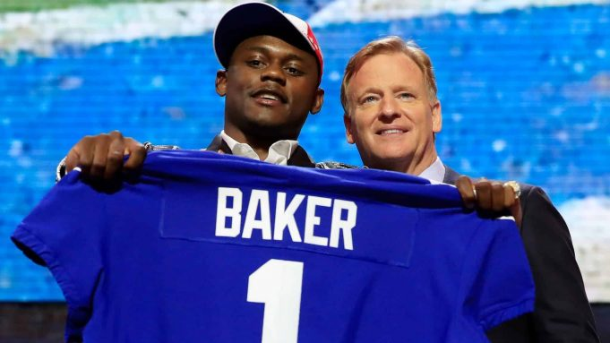 NASHVILLE, TENNESSEE - APRIL 25: Deandre Baker of Georgia poses with NFL Commissioner Roger Goodell after being chosen #30 overall by the New York Giants during the first round of the 2019 NFL Draft on April 25, 2019 in Nashville, Tennessee.