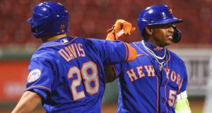 BOSTON, MA - JULY 28: J.D. Davis #28 and Yoenis Cespedes #52 of the New York Mets after Davis' two-run home run in the fifth inning against the Boston Red Sox at Fenway Park on July 28, 2020 in Boston, Massachusetts.