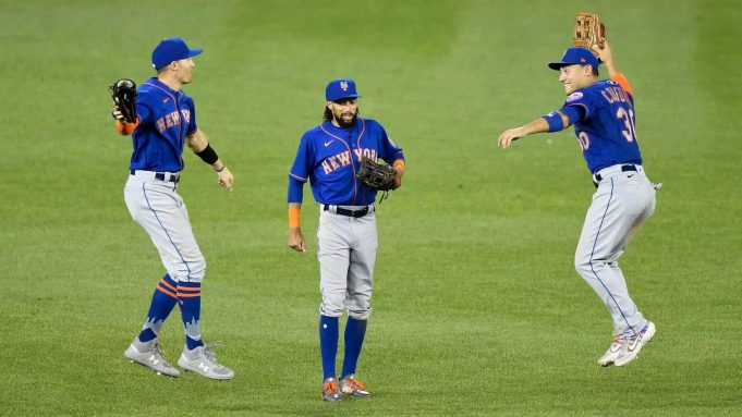 WASHINGTON, DC - AUGUST 05: Brandon Nimmo #9, Billy Hamilton #21 and Michael Conforto #30 of the New York Mets celebrate a 3-1 victory over the Washington Nationals at Nationals Park on August 5, 2020 in Washington, DC.