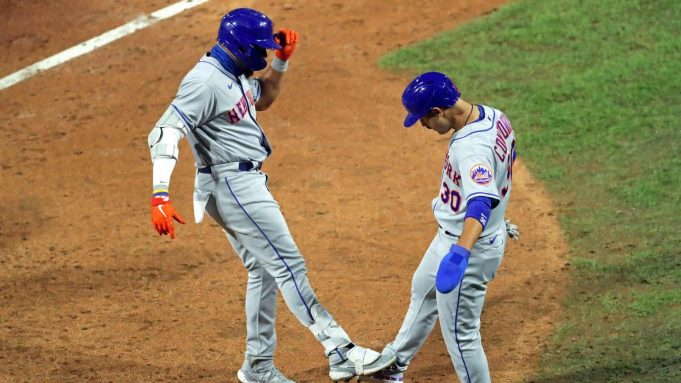 PHILADELPHIA, PA - AUGUST 15: Dominic Smith #2 of the New York Mets celebrates with Michael Conforto #30 after hitting a two-run home run in the ninth inning during a game against the Philadelphia Phillies at Citizens Bank Park on August 15, 2020 in Philadelphia, Pennsylvania. The Phillies won 6-2.