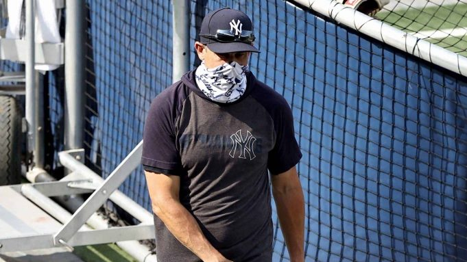 NEW YORK, NEW YORK - JULY 19: Manager Aaron Boone of teh New York Yankees walks on the field before the game against the New York Mets during Summer Camp play at Yankee Stadium on July 19, 2020 in the Bronx borough of New York City.