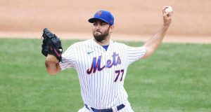 NEW YORK, NEW YORK - AUGUST 13: David Peterson #77 of the New York Mets pitches against the Washington Nationals in the first inning during their game at Citi Field on August 13, 2020 in New York City.