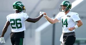 FLORHAM PARK, NEW JERSEY - AUGUST 14: Sam Darnold #14 and Le'Veon Bell #26 of the New York Jets fist bump at Atlantic Health Jets Training Center on August 14, 2020 in Florham Park, New Jersey.