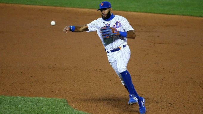 NEW YORK, NEW YORK - AUGUST 25: Amed Rosario #1 of the New York Mets field a ground ball off the bat of Jonathan Villar #2 of the Miami Marlins for an out in the second inning at Citi Field on August 25, 2020 in New York City.