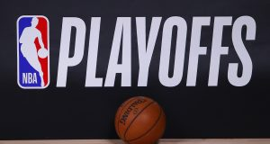 LAKE BUENA VISTA, FLORIDA - AUGUST 26: A basketball sits next to an NBA Playoffs logo in Game Five of the Eastern Conference First Round scheduled between the Milwaukee Bucks and the Orlando Magic during the 2020 NBA Playoffs at AdventHealth Arena at ESPN Wide World Of Sports Complex on August 26, 2020 in Lake Buena Vista, Florida. NOTE TO USER: User expressly acknowledges and agrees that, by downloading and or using this photograph, User is consenting to the terms and conditions of the Getty Images License Agreement.