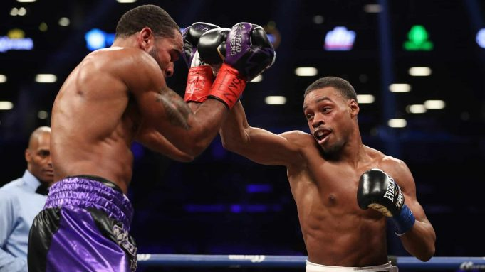 NEW YORK, NY - JANUARY 20: Errol Spence punches Lamont Peterson during their IBF Welterweight title fight at the Barclays Center on January 20, 2018 in New York City.