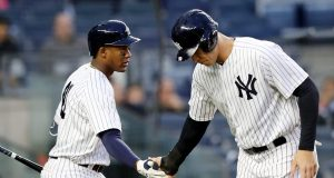 NEW YORK, NY - APRIL 16: Miguel Andujar #41 of the New York Yankees congratulates teammate Aaron Judge #99 after he scored on a bases loaded walk in the first inning against the Miami Marlins at Yankee Stadium on April 16, 2018 in the Bronx borough of New York City.