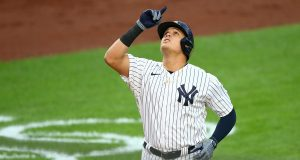 NEW YORK, NEW YORK - AUGUST 15: Gio Urshela #29 of the New York Yankees celebrates after hitting a 2-run home run in the first inning against the Boston Red Sox at Yankee Stadium on August 15, 2020 in New York City.
