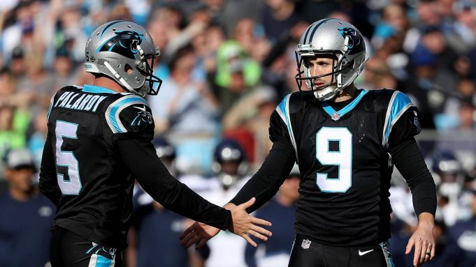 CHARLOTTE, NC - NOVEMBER 25: Graham Gano #9 and teammate Michael Palardy #5 of the Carolina Panthers react after a field goal against the Seattle Seahawks in the second quarter during their game at Bank of America Stadium on November 25, 2018 in Charlotte, North Carolina.