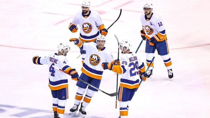 TORONTO, ONTARIO - AUGUST 24: Andy Greene #4 of the New York Islanders is congratulated by his teammates after scoring a goal against the Philadelphia Flyers at 6:06 during the first period in Game One of the Eastern Conference Second Round during the 2020 NHL Stanley Cup Playoffs at Scotiabank Arena on August 24, 2020 in Toronto, Ontario.
