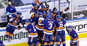 TORONTO, ONTARIO - AUGUST 16: The New York Islanders celebrate the game winning goal by Mathew Barzal #13 against the Washington Capitals during the first overtime period for a 2-1 win in Game Three of the Eastern Conference First Round during the 2020 NHL Stanley Cup Playoffs at Scotiabank Arena on August 16, 2020 in Toronto, Ontario.