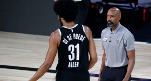 LAKE BUENA VISTA, FLORIDA - AUGUST 21: Head coach Jacque Vaughn of the Brooklyn Nets talks with Jarrett Allen #31 during a break in play against the Toronto Raptors during the second half in game three of the first round of the 2020 NBA Playoffs at The Field House at ESPN Wide World Of Sports Complex on August 21, 2020 in Lake Buena Vista, Florida. NOTE TO USER: User expressly acknowledges and agrees that, by downloading and or using this photograph, User is consenting to the terms and conditions of the Getty Images License Agreement. (