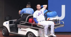 NEW YORK, NEW YORK - AUGUST 13: Jeff McNeil #6 of the New York Mets is carted off the field after injuring his knee crashing into the wall making a diving catch hit by Asdrubal Cabrera #13 of the Washington Nationals in the first inning during their game at Citi Field on August 13, 2020 in New York City.