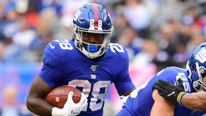EAST RUTHERFORD, NEW JERSEY - OCTOBER 06: Jon Hilliman #28 of the New York Giants carries the ball during the fourth quarter of their game against the Minnesota Vikings at MetLife Stadium on October 06, 2019 in East Rutherford, New Jersey.