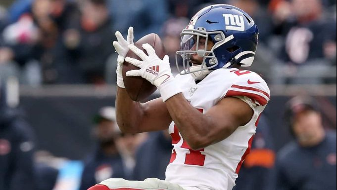 CHICAGO, ILLINOIS - NOVEMBER 24: Julian Love #24 of the New York Giants makes an interception in the fourth quarter against the Chicago Bears at Soldier Field on November 24, 2019 in Chicago, Illinois.