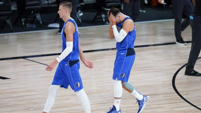 LAKE BUENA VISTA, FLORIDA - AUGUST 21: Kristaps Porzingis #6 and Luka Doncic #77 of the Dallas Mavericks leave the court after the first half of Game Three of the first round of the playoffs at the AdventHealth Arena at the ESPN Wide World Of Sports Complex on August 21, 2020 in Lake Buena Vista, Florida. NOTE TO USER: User expressly acknowledges and agrees that, by downloading and or using this photograph, User is consenting to the terms and conditions of the Getty Images License Agreement.