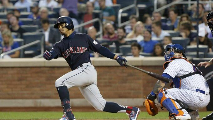 NEW YORK, NEW YORK - AUGUST 20: Francisco Lindor #12 of the Cleveland Indians doubles in the third inning against the New York Mets at Citi Field on August 20, 2019 in New York City.