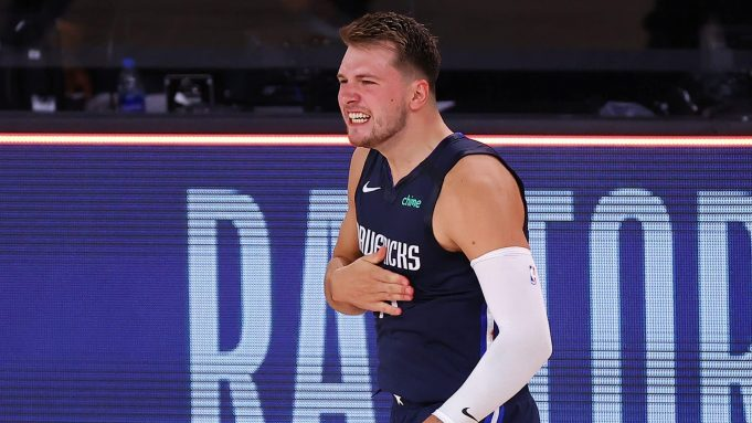 LAKE BUENA VISTA, FLORIDA - AUGUST 23: Luka Doncic #77 of the Dallas Mavericks celebrates a game winning three point basket against the LA Clippers during overtime in Game Four of the Western Conference First Round during the 2020 NBA Playoffs at AdventHealth Arena at ESPN Wide World Of Sports Complex on August 23, 2020 in Lake Buena Vista, Florida. NOTE TO USER: User expressly acknowledges and agrees that, by downloading and or using this photograph, User is consenting to the terms and conditions of the Getty Images License Agreement.