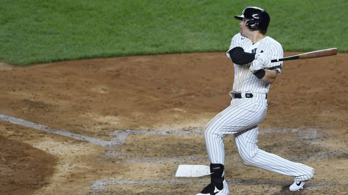 NEW YORK, NEW YORK - AUGUST 18: Luke Voit #59 of the New York Yankees follows through after hitting a two-run home run during the fifth inning against the Tampa Bay Rays at Yankee Stadium on August 18, 2020 in the Bronx borough of New York City.