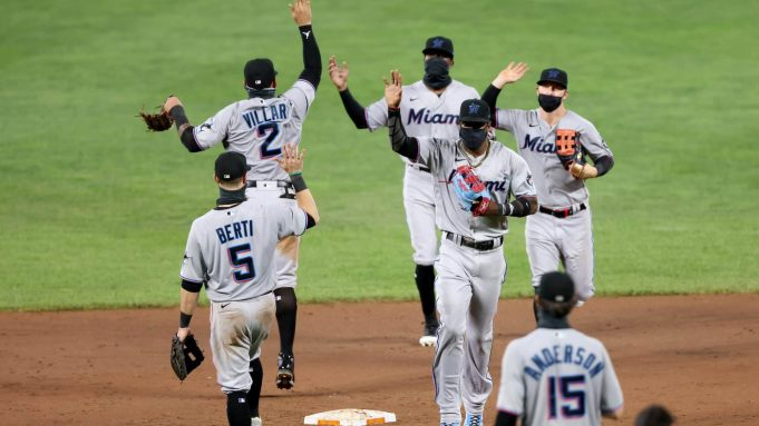 BALTIMORE, MARYLAND - AUGUST 04: Members of the Miami Marlins celebrate their 4-0 win over the Baltimore Orioles at Oriole Park at Camden Yards on August 04, 2020 in Baltimore, Maryland.
