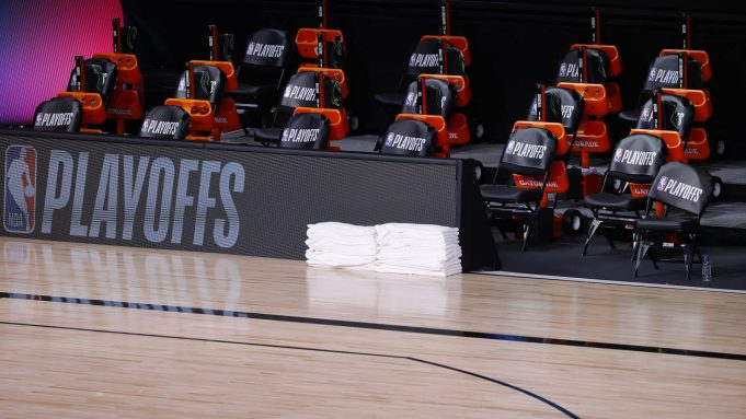 LAKE BUENA VISTA, FLORIDA - AUGUST 26: Benches sit empty at game time of a scheduled game between the Milwaukee Bucks and the Orlando Magic for Game Five of the Eastern Conference First Round during the 2020 NBA Playoffs at AdventHealth Arena at ESPN Wide World Of Sports Complex on August 26, 2020 in Lake Buena Vista, Florida. NOTE TO USER: User expressly acknowledges and agrees that, by downloading and or using this photograph, User is consenting to the terms and conditions of the Getty Images License Agreement.