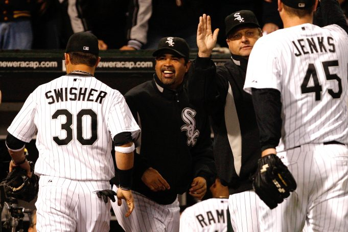 CHICAGO - OCTOBER 05: Manager Ozzie Guillen #13 of the Chicago White Sox celebrates their 5-3 win against the Tampa Bay Rays in Game Three of the ALDS during the 2008 MLB Playoffs at U.S. Cellular Field on October 5, 2008 in Chicago, Illinois.