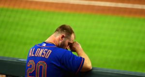 ATLANTA, GA - JULY 31: Pete Alonso #20 of the New York Mets watches play in the ninth inning against the Atlanta Braves at SunTrust Field on June 31, 2020 in Atlanta, Georgia.