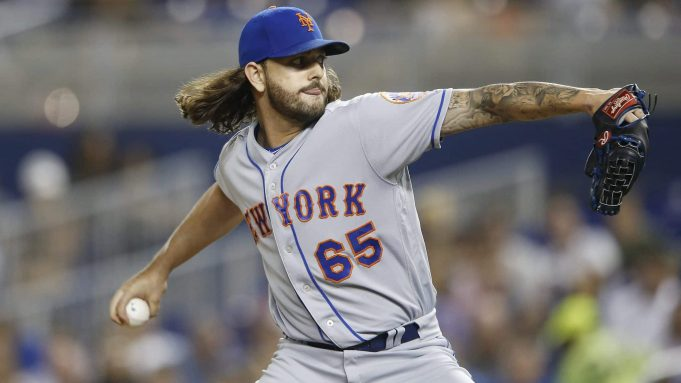 MIAMI, FLORIDA - JULY 12: Robert Gsellman #65 of the New York Mets delivers a pitch in the sixth inning against the Miami Marlins at Marlins Park on July 12, 2019 in Miami, Florida.