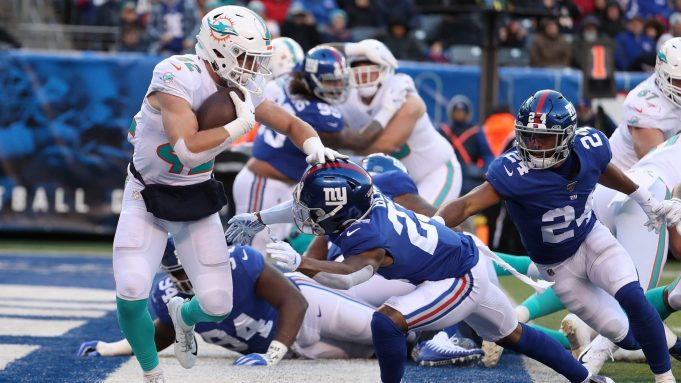 EAST RUTHERFORD, NEW JERSEY - DECEMBER 15: Patrick Laird #42 of the Miami Dolphins is tackled for a safety by Sam Beal #23 of the New York Giants in the third quarter during their game at MetLife Stadium on December 15, 2019 in East Rutherford, New Jersey.