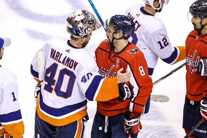 TORONTO, ONTARIO - AUGUST 20: Semyon Varlamov #40 of the New York Islanders shakes hands with Alex Ovechkin #8 of the Washington Capitals after their 2-0 victory in Game Five to win the Eastern Conference First Round during the 2020 NHL Stanley Cup Playoffs at Scotiabank Arena on August 20, 2020 in Toronto, Ontario.