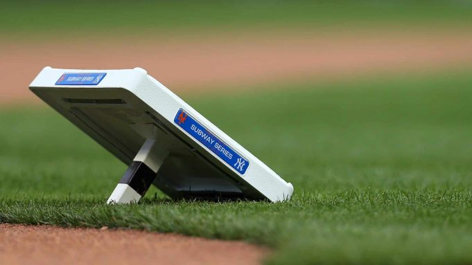 NEW YORK, NY - JUNE 09: Bases adorned with commemorative plaques for the Subway Series wait to be set before a game between the New York Yankees and New York Mets at Citi Field on June 9, 2018 in the Flushing neighborhood of the Queens borough of New York City.