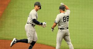 ST PETERSBURG, FLORIDA - AUGUST 08: Aaron Judge #99 of the New York Yankees hits a solo home run in the sixth inning during Game 1 of a doubleheader against the Tampa Bay Rays at Tropicana Field on August 08, 2020 in St Petersburg, Florida.