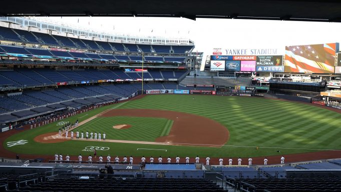 NEW YORK, NEW YORK - JULY 31: The New York Yankees and the Boston Red Sox stand for the national anthem during their home opener at Yankee Stadium on July 31, 2020 in New York City. The 2020 season had been postponed since March due to the COVID-19 pandemic.