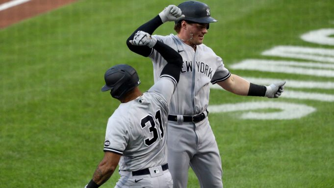 BUFFALO, NEW YORK - SEPTEMBER 07: Aaron Hicks #31 of the New York Yankees and teammate Luke Voit #59 celebrate after Voit hit a one run home run during the first inning against the Toronto Blue Jays at Sahlen Field on September 07, 2020 in Buffalo, New York. The Blue Jays are the home team and are playing their home games in Buffalo due to the Canadian government's policy on coronavirus (COVID-19).