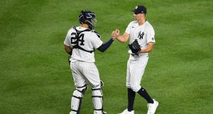 NEW YORK, NEW YORK - AUGUST 14: Ben Heller #61 celebrates with Gary Sanchez #24 of the New York Yankees during the ninth inning against the Boston Red Sox at Yankee Stadium on August 14, 2020 in the Bronx borough of New York City. The Yankees won 10-3.