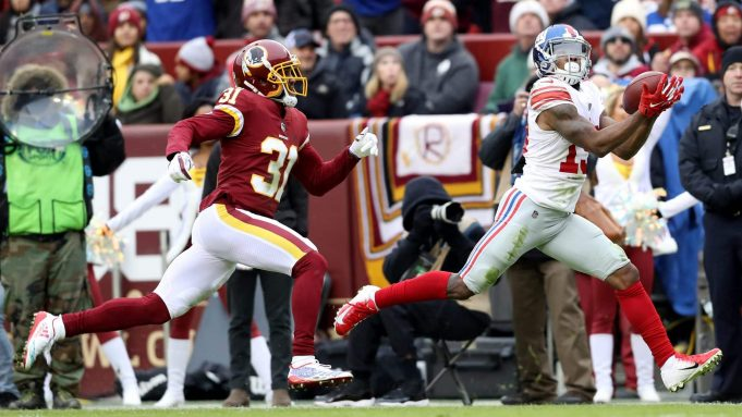 LANDOVER, MARYLAND - DECEMBER 09: Cornerback Fabian Moreau #31 of the Washington Redskins looks on as wide receiver Corey Coleman #19 catches a first half pass at FedExField on December 09, 2018 in Landover, Maryland.