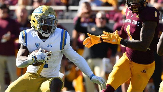 TEMPE, AZ - NOVEMBER 10: Defensive back Darnay Holmes #1 of the UCLA Bruins makes an interception and runs the football 31 yards for a touchdown in the first half against the Arizona State Sun Devils at Sun Devil Stadium on November 10, 2018 in Tempe, Arizona.