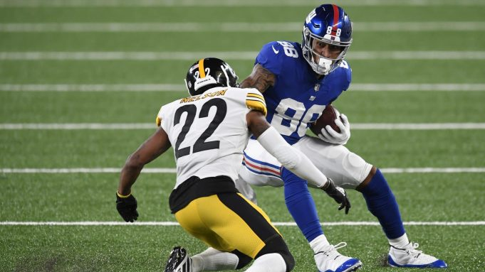 EAST RUTHERFORD, NEW JERSEY - SEPTEMBER 14: Evan Engram #88 of the New York Giants carries the ball as Steven Nelson #22 of the Pittsburgh Steelers defends during the second half at MetLife Stadium on September 14, 2020 in East Rutherford, New Jersey.