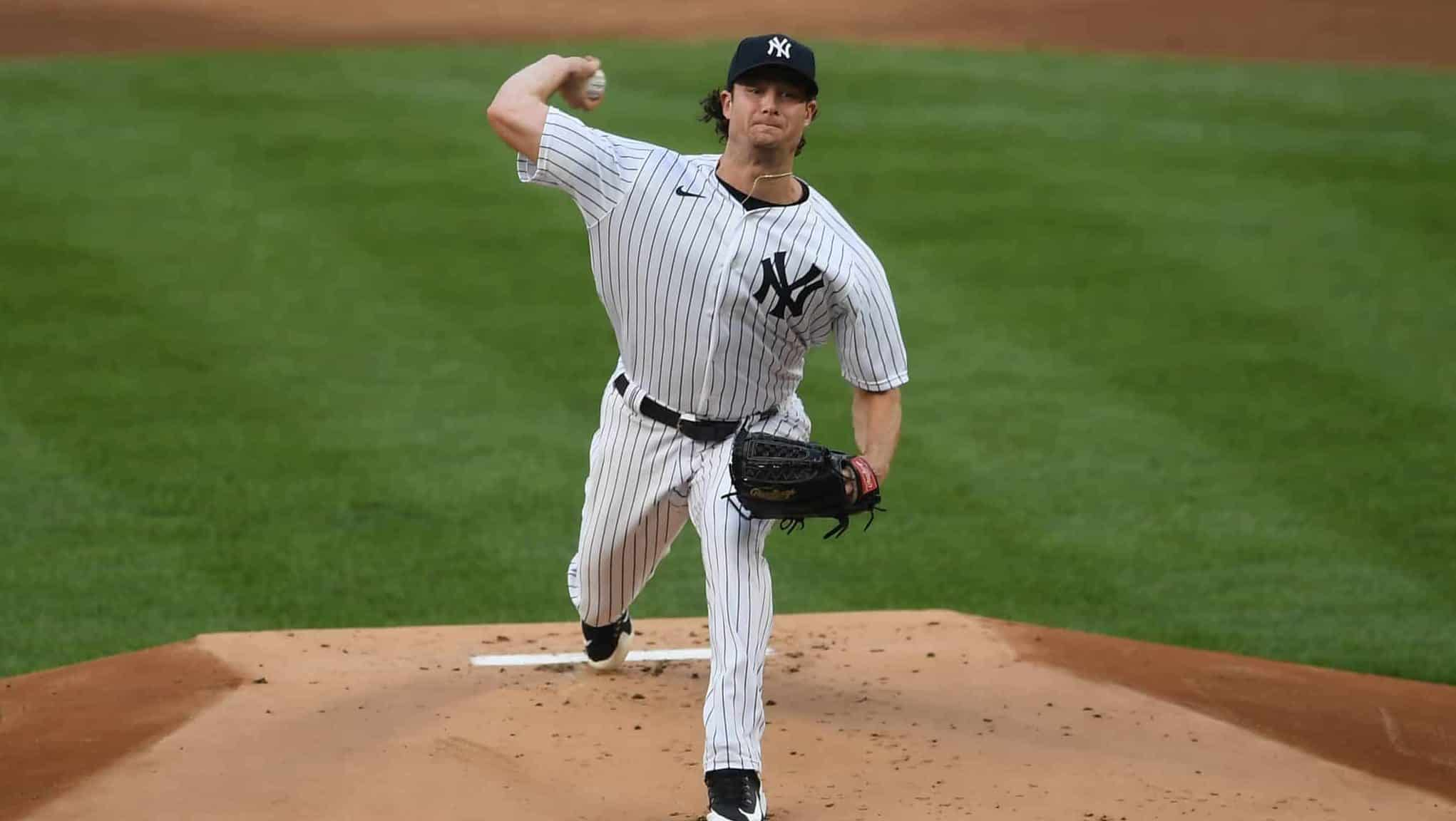 NEW YORK, NEW YORK - AUGUST 14: Gerrit Cole #45 of the New York Yankees pitches during the first inning against the Boston Red Sox at Yankee Stadium on August 14, 2020 in the Bronx borough of New York City.