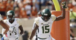 AUSTIN, TX - OCTOBER 13: Denzel Mims #15 of the Baylor Bears celebrates after a touchdown reception in the first half against the Texas Longhorns of the Baylor Bears at Darrell K Royal-Texas Memorial Stadium on October 13, 2018 in Austin, Texas.