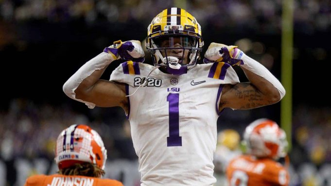 NEW ORLEANS, LOUISIANA - JANUARY 13: Ja'Marr Chase #1 of the LSU Tigers reacts to a touchdown during the first half against the Clemson Tigers in the College Football Playoff National Championship game at Mercedes Benz Superdome on January 13, 2020 in New Orleans, Louisiana.