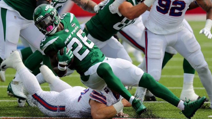 ORCHARD PARK, NY - SEPTEMBER 13: Justin Zimmer #61 of the Buffalo Bills dives to make a tackle on Le'Veon Bell #26 of the New York Jets during the first quarter at Bills Stadium on September 13, 2020 in Orchard Park, New York.