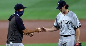 BALTIMORE, MARYLAND - JULY 29: Manager Aaron Boone of New York Yankees relieves starting pitcher Gerrit Cole #45 during their game against the Baltimore Orioles at Oriole Park at Camden Yards on July 29, 2020 in Baltimore, Maryland.