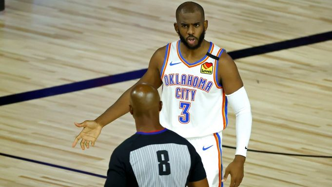 LAKE BUENA VISTA, FLORIDA - AUGUST 05: Chris Paul #3 of the Oklahoma City Thunder discusses a call with referee Marc Davis #8 during the second quarter against the Los Angeles Lakers at HP Field House at ESPN Wide World Of Sports Complex on August 05, 2020 in Lake Buena Vista, Florida. NOTE TO USER: User expressly acknowledges and agrees that, by downloading and or using this photograph, User is consenting to the terms and conditions of the Getty Images License Agreement.