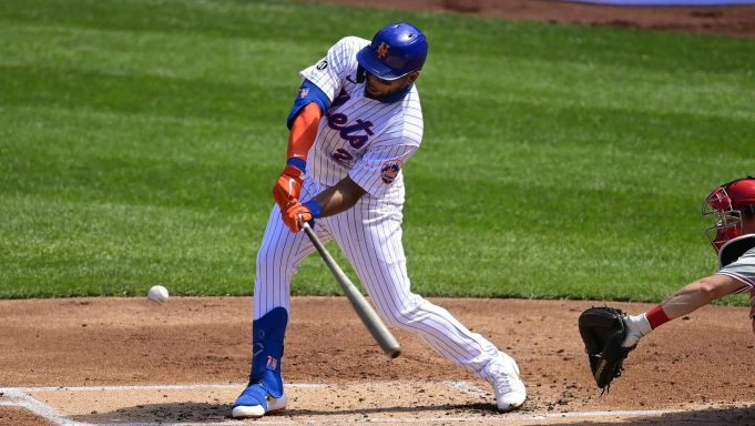 NEW YORK, NEW YORK - SEPTEMBER 06: Dominic Smith #2 of the New York Mets hits an RBI double against the Philadelphia Phillies during the first inning at Citi Field on September 06, 2020 in New York City.