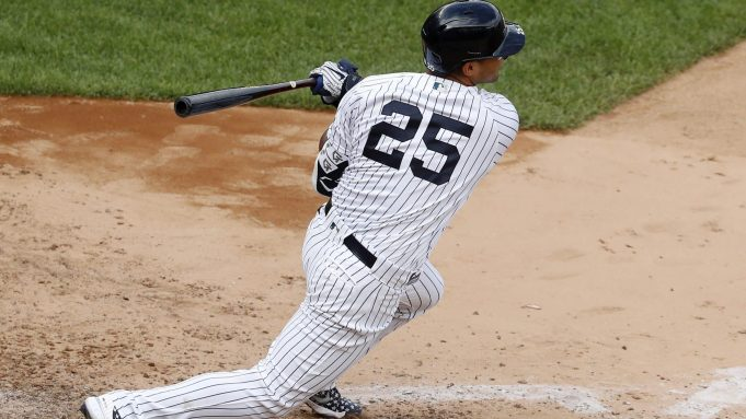 NEW YORK, NEW YORK - SEPTEMBER 13: Gleyber Torres #25 of the New York Yankees follows through on his eighth inning pinch hit two run double against the Baltimore Orioles at Yankee Stadium on September 13, 2020 in New York City.